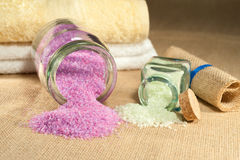 Bath salts. Of different colors isolated on rustic background Stock Photography