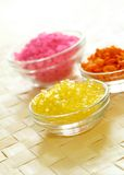Bath salts in glass bowls on wooden.Spa essentia Royalty Free Stock Images