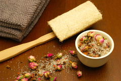 Bath salts, loofah, and towel Stock Photos