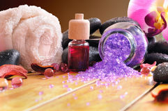 Bath salts and oils on wooden brown background Stock Images