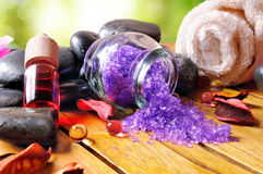 Bath salts and oils on wooden in nature Stock Photo