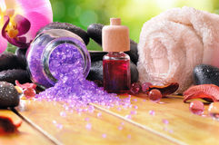 Bath salts and oils on wooden in nature front view Stock Photo