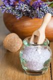 Bath Salts With Scoop. Luxury bath salts with wooden scoop and lavender Royalty Free Stock Photography
