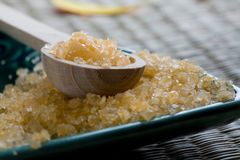 Bath salts in spoon and dish. Royalty Free Stock Images