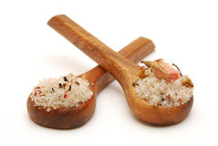 Bath salts on spoons. Bath salts on wooden spoons isolated Stock Photo