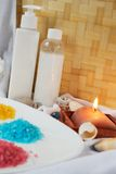 Bath sea salt. Spa essentials with various sea salts for relaxation with candle Royalty Free Stock Image
