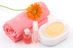 Bath set and essential oil. With gerbera daisy on white background Royalty Free Stock Photo