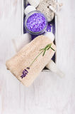 Bath set with lavender, Luffa sponge,salt, pumice and lotion in an metal box Stock Photo
