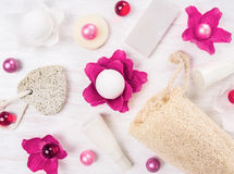Bath set with pink oil balls on white wooden table Stock Photo