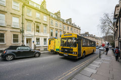 Bath shoolbus in United kingdom Yellow bus. BATH, UNITED KINGDOM - MAR 7, 2017: Yellow school bus in Bath, united kingdom transporting kids on the street of the Stock Photo