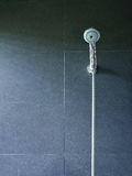 Bath shower on black tile wall Royalty Free Stock Photography