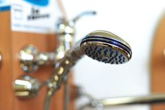 Bath shower head. Bath shower silver head in bathroom Royalty Free Stock Photo