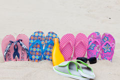 Bath slippers on beach Royalty Free Stock Images