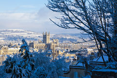 Bath in the snow. Winter scenic showing Bath Abbey surrounded by Georgian architecture and countryside in Bath, England, UK Stock Images
