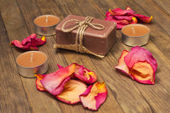 Bath soap with candle and dry rose petal Stock Image