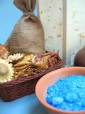 Bath soaps and salts at spa. A view of bath soaps and salts for beauty and skin treatments as found at a health spa.  Blue background Royalty Free Stock Photos
