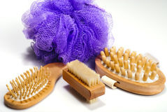 Bath spa kit. Bath anti-cellulitis spa massage kit with comb, hairbrush, brush and violet sponge isolated on white background. With shadow stock image