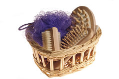 Bath spa kit. Bath anti-cellulitis spa massage kit with comb, brush, sponge and hairbrush in basket isolated on white background stock photo