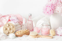 Bath and spa with peony flowers beauty products brush towels Stock Photo