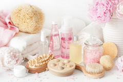 Bath and spa with peony flowers beauty products brush towels Royalty Free Stock Photography