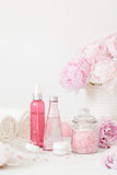 Bath and spa with peony flowers beauty products towels Royalty Free Stock Images