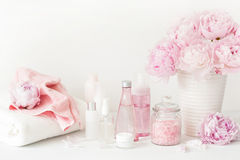 Bath and spa with peony flowers beauty products towels Stock Images