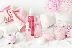 Bath and spa with peony flowers beauty products towels Stock Photography
