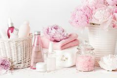 Bath and spa with peony flowers beauty products towels Stock Photo