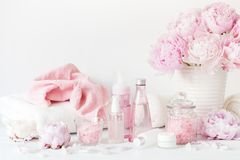 Bath and spa with peony flowers beauty products towels Royalty Free Stock Image