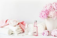 Bath and spa with peony flowers beauty products towels Stock Image