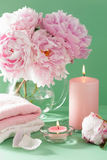 Bath and spa with peony flowers candles towels Royalty Free Stock Photos