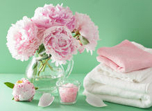 Bath and spa with peony flowers herbal salt towels Stock Photos