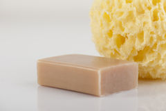 Bath sponge and natural soap stock images