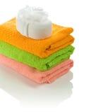 Bath sponge on towels Royalty Free Stock Image