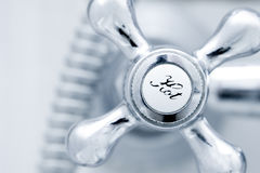 Bath tap. With hot sign  close up Royalty Free Stock Photo