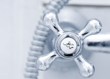 Bath tap with hot sign Stock Photography