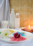 Bath theme. Spa essentials with various sea salts for relaxation with candle Stock Photography