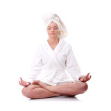 Bath time. Young beautiful caucasian woman after bath in lotus position stock photography