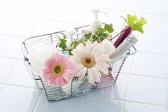 Bath time. Oil, salt and flower in bathroom Stock Photos