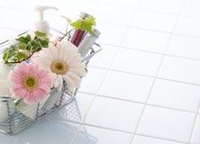 Bath time. Oil, salt and flower in bathroom Stock Photography