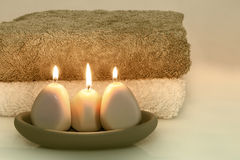 Bath Time. Candles and fresh towels. Refreshment awaits royalty free stock photography