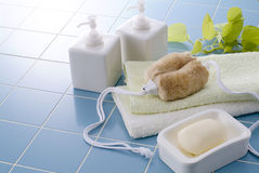 Bath time. Towels, soap, shampoo and body brush for bath time Stock Photos