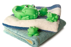 Bath time. Clean towels and frog toys for children's happy bath time Royalty Free Stock Photography