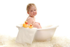 Bath Time. A young girl with bubbles in bathtub Stock Image