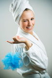 Bath time!. Young cute girl with bath sponge royalty free stock photography