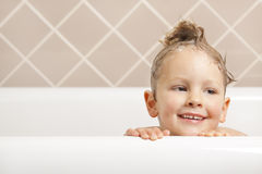 Bath time. A gorgeous young boy has fun in the bath royalty free stock image