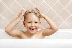 Bath time. A gorgeous young boy has fun in the bath Royalty Free Stock Photography