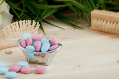Bath Time color tablets for kids on wood background. With spa kit royalty free stock photography