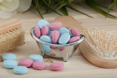Bath Time color tablets for kids on wood background. With spa kit stock image
