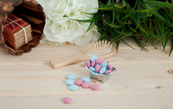 Bath Time color tablets for kids on wood background. With spa kit stock images